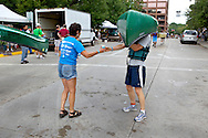 .The 33rd annual Paddle & Portage canoe race was held Saturday July 21, 2012 at James Madison Park in Madison. The race involves a 1.5 mile paddle on Lake Mendota, a 1-mile portage across downtown Madison, and a a 1.5 mile portage across Lake Monona.