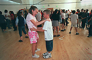 Sara Meyer 11, and Trey Lehrman 10, (both in 5th grade) dance tentatively during a lunchtime dance at Crocker-Riverside Elementary School, Friday, March 23, 2001.  The event, planned by the school's student council for the 5th and 6th grade classes, was eagerly anticipated by many of the students for weeks.