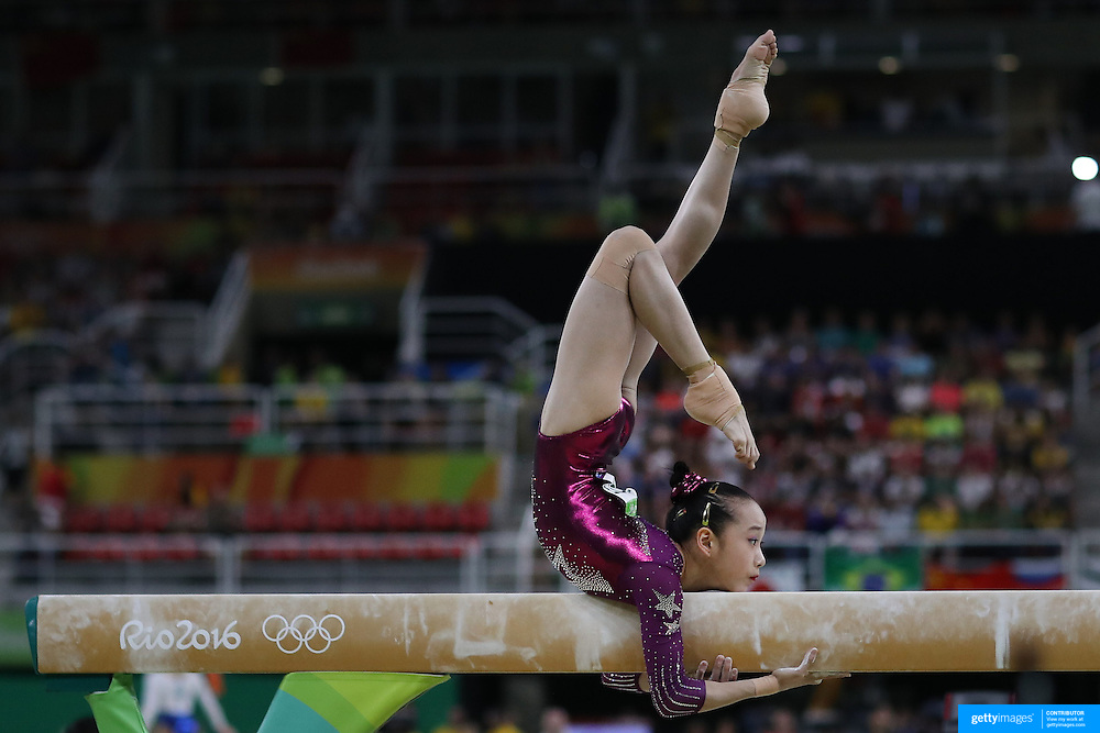 Gymnastics - Olympics: Day 4   Yilin Fan of China performing her routine on the Balance Beam during the Artistic Gymnastics Women's Team Final at the Rio Olympic Arena on August 9, 2016 in Rio de Janeiro, Brazil. (Photo by Tim Clayton/Corbis via Getty Images)