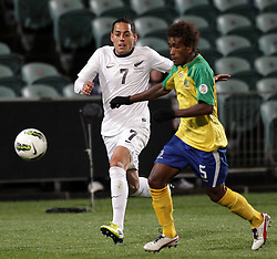 New Zealand's Leo Bertos chases Solomon Islands' Freddie Kini to the ball in a FIFA World Cup Qualifier Match, North Harbour Stadium, Auckland, New Zealand, Tuesday, September 11, 2012.  Credit:SNPA / David Rowland