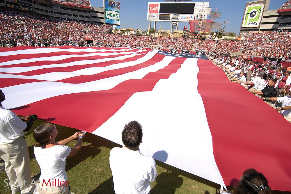 Nov. 4, 2007; Tampa, FL, USA;  The United States flag is displayed prior to the Arizona Cardinals versus Tampa Bay Buccaneers at Raymond James Stadium. ...©2007 Scott A. Miller