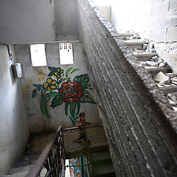 A young girl walks down the destroyed stairway of her home, which was bombed by Israeli artillery fire, Beit Hanoun, Gaza Strip, Palestinian Territories, Nov. 16, 2006. Israel blames the incident on a targeting error and expresses regret. According to Human Rights Watch, since September 2005, Israel has fired about 15,000 rounds at Gaza while Palestinian militants have fired around 1,700 back.