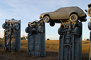 In a strange and eclectic monument, a farmer outside of Alliance, NE assembled a collection of vintage cars to resemble the famous rock formation in England called Stonehenge. All of these old cars were painted gray to look like the rocks of the British oddity.