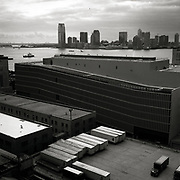 UPS truck trailers parked on the roof in the foreground of the DSNY sanitation garage.