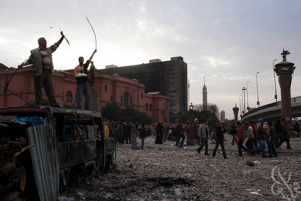 Anti-Hosni Mubarak protesters celebrate atop makeshift barricades after repelling repeated charges by Mubarak supporters on the edges of the Tahrir square area February 03, 2011  in Cairo, Egypt. Protesters from both sides clashed throughout the day, throwing rocks and fighting at close range.  .Photo by Scott Nelson