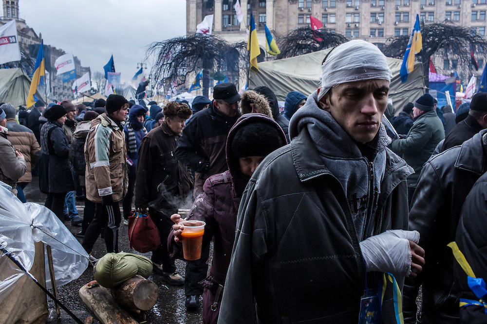 KIEV, UKRAINE - DECEMBER 7: A man who was injured in clashes with the Berkut police force attends a rally of anti-government protesters wrapped in bandages on December 7, 2013 in Kiev, Ukraine. The violent confrontation in the early morning hours increased the outrage and number of protesters exponentially. (Photo by Brendan Hoffman/Getty Images)