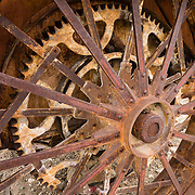 An antique tractor wheel rusts at the Eastern California Museum, 155 N. Grant Street, Independence, California, 93526, USA. The Museum was founded in 1928 and has been operated by the County of Inyo since 1968. The mission of the Museum is to collect, preserve, and interpret objects, photos and information related to the cultural and natural history of Inyo County and the Eastern Sierra, from Death Valley to Mono Lake.