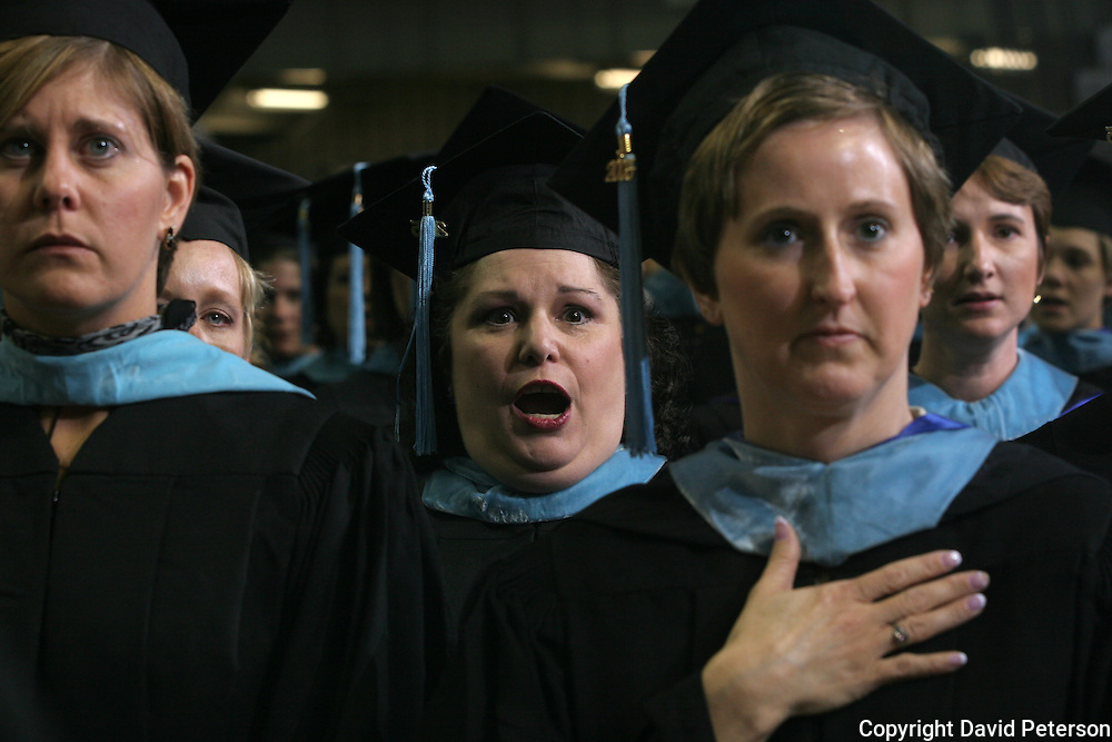 Drake University graduates sing the school song at commencement exercises in 2005...The private University in Des Moines, Ia., has been lauded for it's outstanding programs in the arts in addition to having one of the best law schools and pharmacy departments in the country.