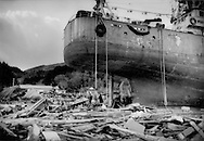 An ocean going ship sits where it came to rest in the debris of the great 25m high (82 ft.) tsunami that hit Kesennuma, Miyagi Prefecture following the massive earthquake that struck under the sea off of Japan.