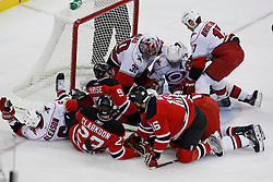 Apr 23, 2009; Newark, NJ, USA; Carolina Hurricanes goalie Cam Ward (30) looks for the puck through a pileup of players during the first period of game five of the eastern conference quarterfinals of the 2009 Stanley Cup playoffs at the Prudential Center.