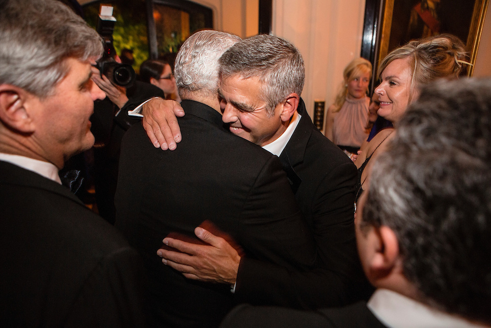 George Clooney hugs former Secretary of State Colin Powell at the Bloomberg Vanity Fair White House Correspondents' Association dinner afterparty at the residence of the French Ambassador on Saturday, April 28, 2012 in Washington, DC. Brendan Hoffman for the New York Times