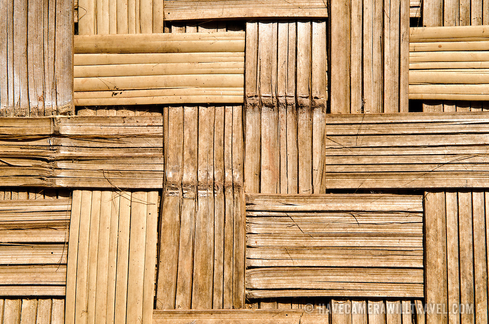 The woven bamboo lattice forming the wall of a house in Lakkhamma Village in Luang Namtha province in northern Laos. Lakkhamma Village was established as a joint project between the Lao government and the European Commission.