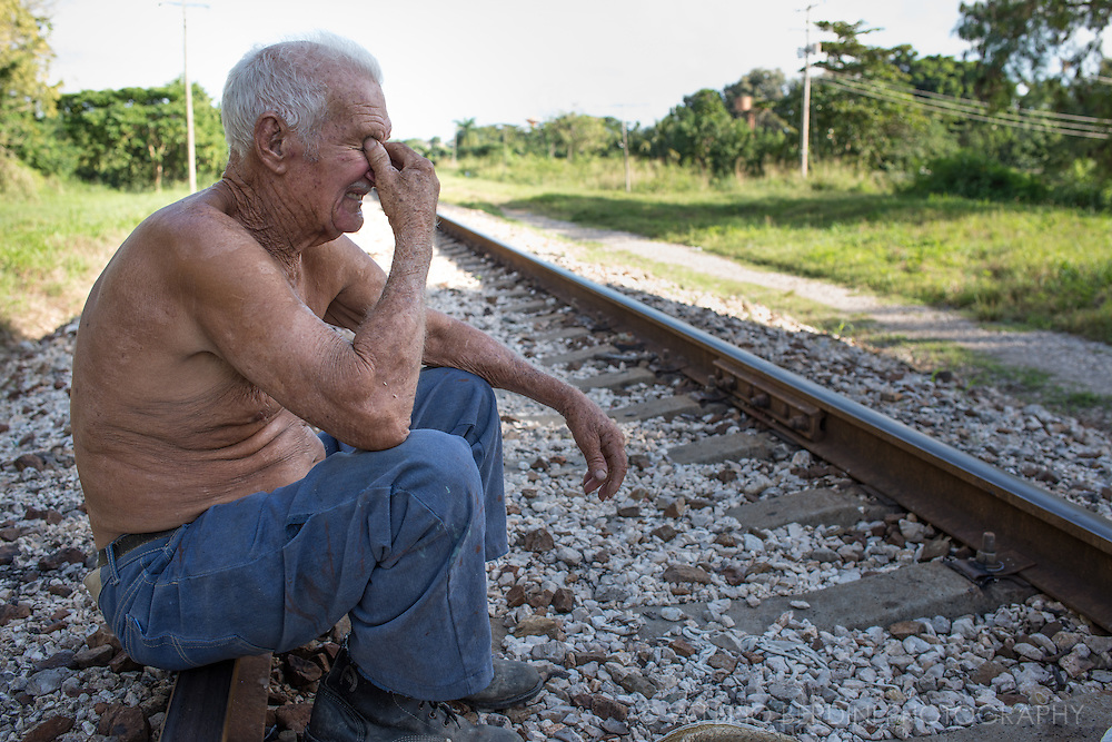 a cart owner waits for a ride sitting on a railway in Santa Clara. This is close to the spot where Che Guevara with his guerrilleros derailed a train transporting Batista troops at the apex of the Cuban revolution.