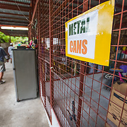 CAPTION: Door-to-door waste collection is undertaken using mobile carts. The waste is brought here, to the materials recovery centre, where volunteers separate and recycle it. Previously, inadequate waste disposal was causing waterways to block, increasing the severity of flooding. The Climate Core Team has recognised this initiative as a 'best practice' for increasing urban climate change resilience and it has also been identified as a potential initiative for replication across other barangays. LOCATION: Materials Recovery Facility and Urban Garden, East Rembo Barangay, Makati City, Metro Manila, Philippines. INDIVIDUAL(S) PHOTOGRAPHED: N/A.