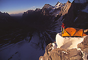 """The late American mountaineer Alex Lowe coils a rope at a camp while climbing """"The Bird"""" a peak in the Ak Su Region of the Pamir Atlai Mountains, Kyrgyzstan."""