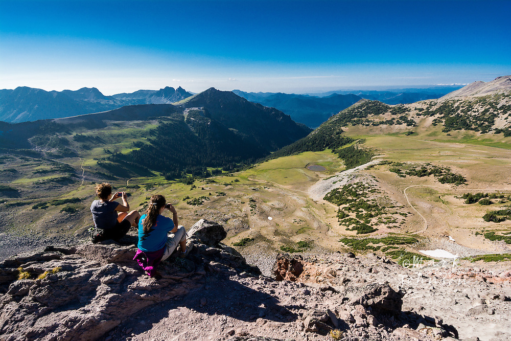 """Women hikers taking photographs of the view from the Burroughs Mountain Trail & enjoying the view in the """"Sunrise"""" section of Mt. Rainier National Park, Washington, USA"""