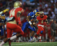Oxford High's Kenzie Phillips (25) runs for a first quarter touchdown vs. Lafayette High in the annual Crosstown Classic football game, at William L. Buford Stadium at LHS, in Oxford, Miss. on Friday, September 13, 2013. Oxford High won 30-0.
