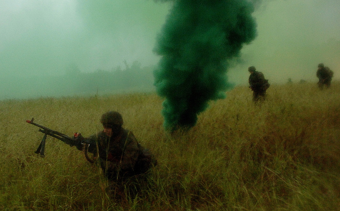 Australian soldiers pop smoke and advance on Camp Raspberry in hopes of securing the city. — © Tsgt Jeremy Lock/