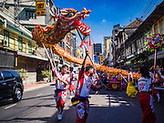 27 JANUARY 2017 - BANGKOK, THAILAND: Chinese dragon dancers perform at a Chinese Shrine in Bangkok on Chinese New Year. 2017 is the Year of the Rooster in the Chinese zodiac. This year's Lunar New Year festivities in Bangkok were toned down because many people are still mourning the death Bhumibol Adulyadej, the Late King of Thailand, who died on Oct 13, 2016. Chinese New Year is widely celebrated in Thailand, because ethnic Chinese are about 15% of the Thai population.       PHOTO BY JACK KURTZ