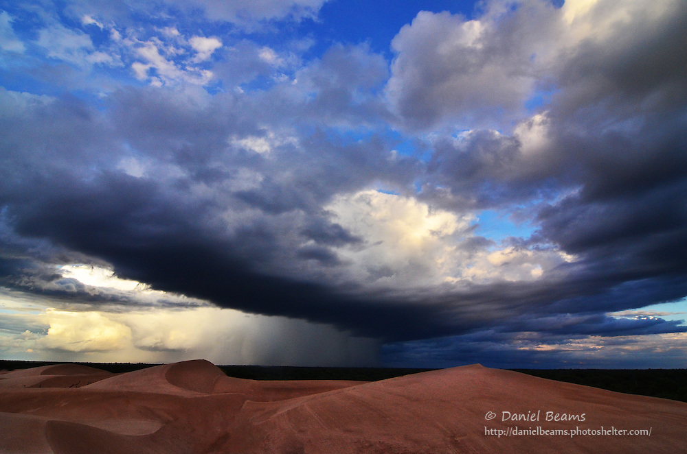 Storm over sand dunes in Isosog