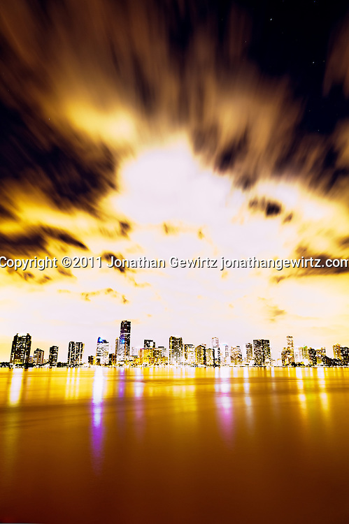Overexposed view of the downtown Miami, Florida bayfront at night, showing hotels, condos and office buildings. WATERMARKS WILL NOT APPEAR ON PRINTS OR LICENSED IMAGES.