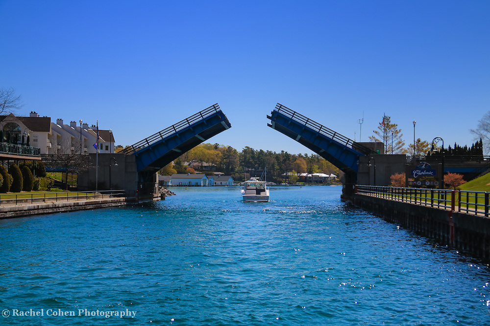 &quot;Through the Drawbridge&quot;<br /> <br /> Watching a boat pass through the drawbridge in Charlevoix Michigan on a beautiful day!
