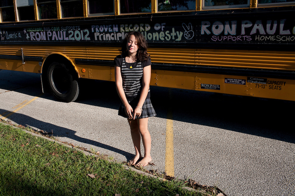 Xoey Halldorson, age 13, stands outside her family's bus, in which they tour the country in support of Republican presidential candidate Ron Paul, at the Republican presidential debate on Thursday, August 11, 2011 in Ames, IA.