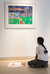 Christies, St James, London, March 4th 2016. A girl from Charlton Manor Primary School admires  Tom Hammick's reduction woodcut &quot;Trailer&quot; created in 2014, at the preview for the It&rsquo;s Our World charity auction at Christie's. Over 40 leading artists including David Hockney, Sir Antony Gormley, David Nash, Sir Peter Blake, Yinka Shonibare, Sir Quentin Blake, Emily Young and Maggi Hambling have committed artworks to the It&rsquo;s Our World Auction in support of The Big Draw and Jupiter Artland Foundation, to be sold at Christie&rsquo;s London on 10 March 2016.<br />  ///FOR LICENCING CONTACT: paul@pauldaveycreative.co.uk TEL:+44 (0) 7966 016 296 or +44 (0) 20 8969 6875. &copy;2015 Paul R Davey. All rights reserved.