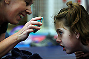 MELISSA LYTTLE       Times<br /> SP_351237_LYTT_TWINS_7 (June 27, 2012, Clearwater, Fla.) Linda Morley, a third year physical therapy student at USF, has been working with Olivia Scheinman during her 17-week rotation, using an iPod playing cartoons as incentive to help Olivia lift her head and stretch her neck muscles. [MELISSA LYTTLE, Times]