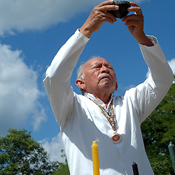 """Mexico, Yucatan, Mayapan, October 17, 2010. Mayan high priest Ildelfonso Ake Cocom conducts a """"saka"""" purification ceremony on the grounds of Mayapan, a ruined Yucatecan capital city dating from the period between 1220 and 1240 AD. Photographs commissioned by SECTUR. More at MexicoCulturalCalendar.com"""
