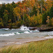 &quot;Autumn Color and Waves&quot;<br /> <br /> Beautiful fall color mixed in with evergreen trees along the shores of Lake Superior with waves crashing against the rocks!