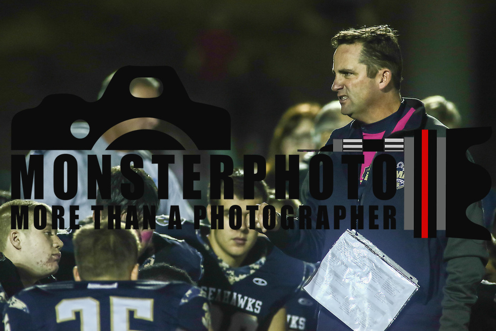 Delaware Military Academy Head coach Michael Ryan talks to his players after a Week 8 DIAA football game between Laurel and Delaware Military Academy Saturday, Oct. 29, 2016, at Baynard Stadium in Wilmington.