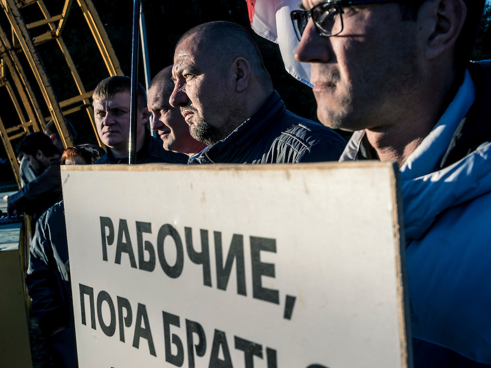 Men attend a rally by indpendent union workers for better pay and jobs, held in a park on the north end of the city out of view of most people, on Wednesday, October 7, 2015 in Minsk, Belarus. A presidential election is planned for Sunday with current president Alexander Lukashenko expected to secure a fifth term, though as in the past, the election is not expected to be declared free by monitors or the opposition.