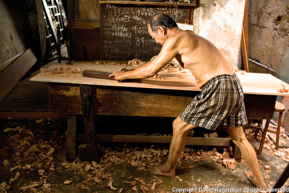 Traditional crafts and trades are still practiced in GT. Here, a furniture restorer.