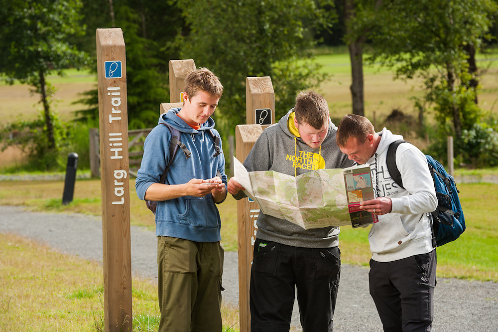 Walkers planning route at Kirroughtree, Forestry Commission, Scotland