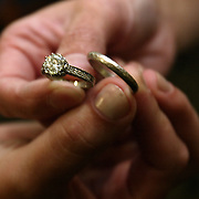 The wedding rings are displayed forever a symbol of the couple's commitment to one another.
