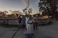 Sunset pray in a garden of Havana.