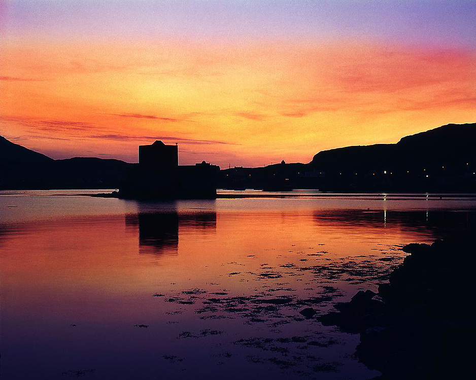 Sunset over Castlebay and Kisimul Castle, Island of Barra, Hebrides.