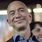 October 11, 2013 - Seattle, Washington, United States: Amazon.com Founder and CEO Jeff Bezos listens during a launch event for the Bezos Center for Innovation at the Museum of History and Industry. Bezos is also the owner of The Washington Post and founder of Blue Origin.