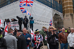 Whitehall, London, April 4th 2015. As PEGIDA UK holds a poorly attended rally on Whitehall, scores of police are called in to contain counter protesters from various London anti-fascist movements. PICTURED: Clearly outnumbered by the media, the police and anti-fascism counter-protesters, the few attending the PEGIDA rally continue undaunted with the proceedings.