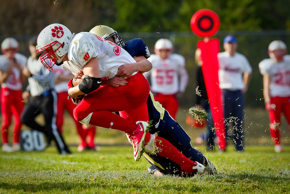 Weiser High's Tyrell Braun keeps his legs moving as he drags a Timberlake High defender during the second half of the 3A State playoff game Saturday in Spirit Lake.