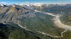 Constantine Metal Resources Ltd. of Vancouver, British Columbia along with investment partner Dowa Metals &amp; Mining Co., Ltd. of Japan is exploring a potential site for a mine (located on the far left edge of image and beyond) just above Glacier Creek (foreground) and the Klehini River (right side of image). The border with British Columbia is at the upper right. This area above Glacier Greek, known as the Palmer Deposit is located near mile 40 of the Haines Highway.<br /> <br /> The minerals that Constantine&rsquo;s drilling explorations have found are primarily copper and zinc, with significant amounts of gold and silver. Exploratory drilling to refine the location and mineral amounts are the current focus of the company.<br /> <br /> If approved and developed, the mine, near Haines, Alaska would be an underground mine. Besides the actual ore deposits, having the nearby highway access for transporting ore to the deepwater port at Haines is also attractive to Constantine. The Haines Highway can be seen in photo on the right.<br /> <br /> Support for a large scale mine such as the Constantine project is divided among residents of Haines, a small community in Southeast Alaska 75 miles northwest of Juneau. The community&rsquo;s needed economic boost from jobs, development and other mine support that a large-scale mine brings is tempting to some. To others, anything that might put the salmon spawning and rearing habitat and watershed resources at risk is simply unimaginable and unacceptable. Of particular concern is copper and other heavy metals in mine waste leaching into the Klehini River (shown) and the Chilkat River 14 miles downstream. Copper and heavy metals are toxic to salmon and bald eagles.<br /> <br /> The Chilkat River chum salmon are the primary food source for one of the largest gatherings of bald eagles in the world. Each fall, bald eagles congregate in the Alaska Chilkat Bald Eagle Preserve, located only three miles downriver from the area of current