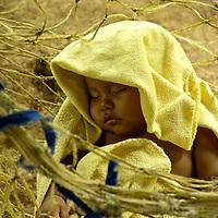 Child sleeping on a hammock.  Indigenous Ngo?be Bugle? Community. Chiriqui. Panama.