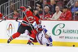 Oct 21, 2014; Newark, NJ, USA; New York Rangers center Dominic Moore (28) is tripped by New Jersey Devils right wing Jaromir Jagr (68) during the first period at Prudential Center.