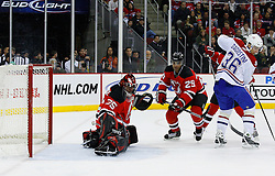 Jan 2, 2009; Newark, NJ, USA; New Jersey Devils goalie Scott Clemmensen (35) makes a mask save during the first period at the Prudential Center.