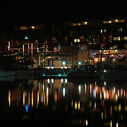 Reflection of the lights of a hotel and night club against the waterway in Lake Havasu City, Arizona.