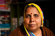 Portrait of a bangle seller in a backstreet shop in Udaipur India