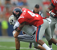 BYU's Jake Heaps (9) is sacked by Ole Miss' Marcus Temple(4) at Vaught-Hemingway Stadium in Oxford, Miss. on Saturday, September 3, 2011. BYU won 14-13.