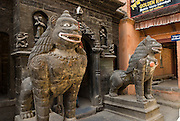 """Stone beasts guard the Golden Temple (Hiranya Varna, or Suwarna Mahavihara), which is a Buddhist Monastery existing since 1409 or earlier, located just north of Patan's Durbar Square, in Nepal, Asia. Patan was probably founded by King Veer Deva in 299 AD from a much older settlement. Patan, officially called Lalitpur, the oldest city in the Kathmandu Valley, is separated from Kathmandu and Bhaktapur by rivers. Patan (population 190,000 in 2006) is the fourth largest city of Nepal, after Kathmandu, Biratnagar and Pokhara. The Newar people, the earliest known natives of the Kathmandu Valley, call Patan by the name """"Yala""""  (from King Yalamber) in their Nepal Bhasa language. UNESCO honored Patan's Durbar Square (Palace Square) as one of the seven monument zones of Kathmandu Valley on their World Heritage List in 1979. All sites are protected under Nepal's Monuments Preservation Act of 1956."""
