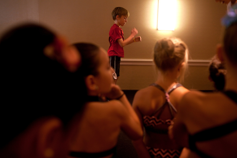 New York, NY - July 05, 2013 : Luke Spring, 10, center, dances on stage during the Mini Jazz Class at the New York City Dance Alliance National Summer Workshop held at the Sheraton New York Times Square Hotel in New York, NY on  July 05, 2013. Luke Spring, a dance prodigy from Studio Bleu Dance Center in Ashburn, VA, has performed on the Tonys, Ellen, So You Think You Can Dance and The Ford Gala. His sisters Cami Spring, 20, and Lucy Spring, 18, are both award winning dancers. (Photo by Melanie Burford/Prime for The Washington Post)